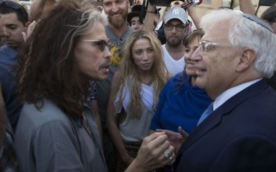 Newly arrived Ambassador to Israel David Friedman speaks with Aerosmith singer Steven Tyler at the Western Wall, the holiest site where Jews can pray in Jerusalem's Old City, Monday, May 15, 2017. (AP Photo/Sebastian Scheiner)
