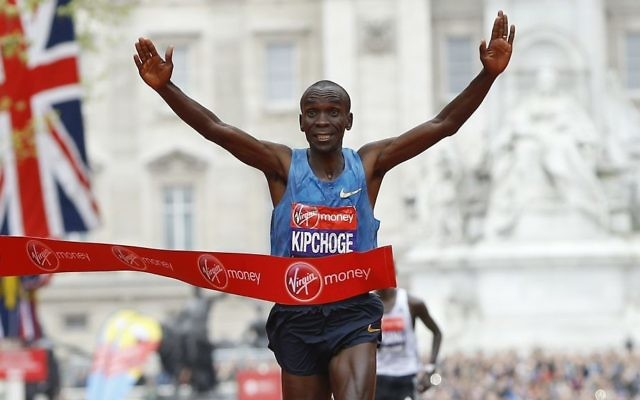 In this Sunday, April 26, 2015 file photo, Eliud Kipchoge of Kenya wins the Men's race in the 35th London Marathon. (AP Photo/Kirsty Wigglesworth)