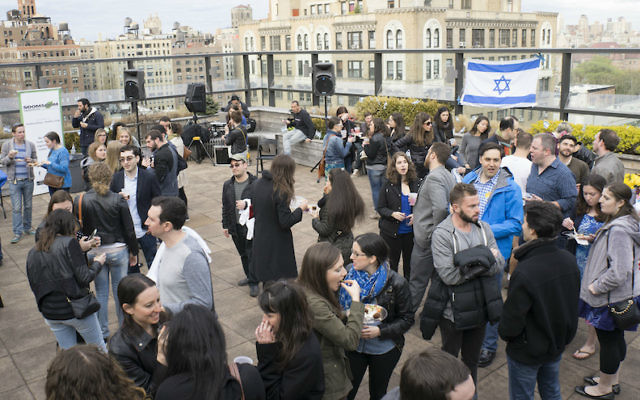 Participants in a past Shavuot program at JCC Manhattan gather on the JCC's roof. The JCC's annual event lasts all night and features an array of classes and workshops. (Courtesy of JCC Manhattan/via JTA)