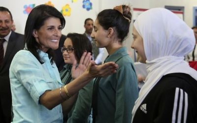 US Ambassador to the United Nations Nikki Haley, second left, meets with Syrian refugee students, in Amman, Jordan, Sunday, May 21, 2017. (AP/Raad Adayleh, Pool)