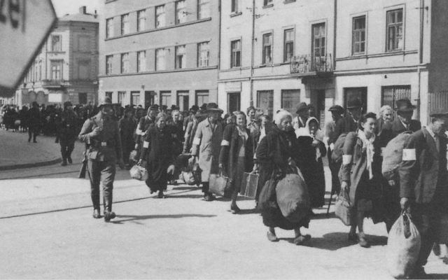 Jews are marched through the streets during the liquidation of the Krakow Ghetto, 1943 (Public Domain/Wikimedia Commons)