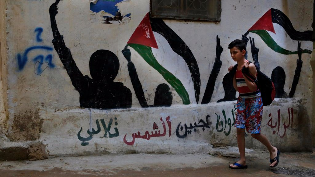 In This Thursday May   Photo A Boy Walks By Graffiti Of