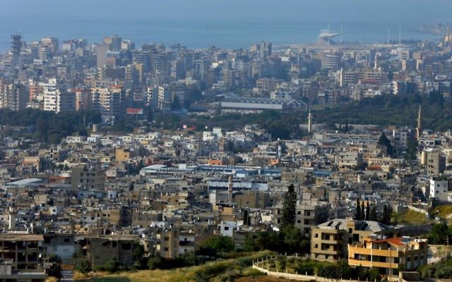 In this Friday, May 5, 2017 photo, a general view, foreground, of the Ein el-Hilweh Palestinian refugee camp near the southern port city of Sidon, Lebanon. (AP Photo/Bilal Hussein)