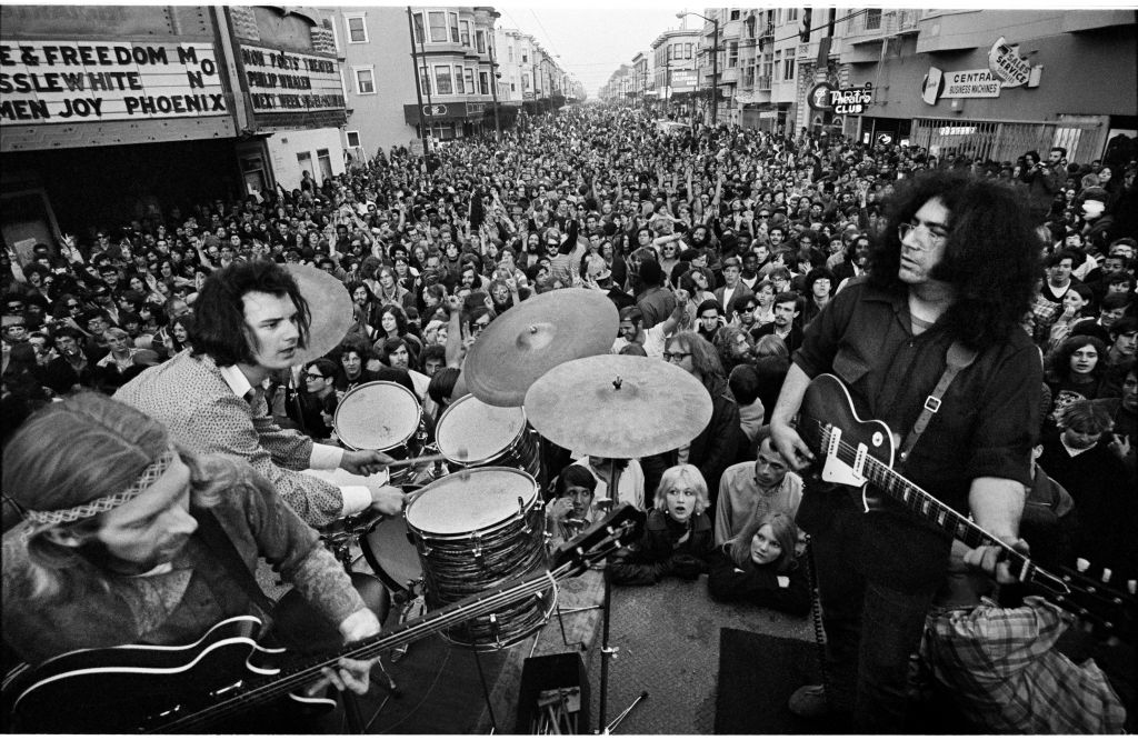 From left to right, Phil Lesh, Bill Kreutzmann, Jerry Garcia, during a Grateful Dead concert on Haight Street, March 3, 1968. (© Jim Marshall Photography, LLC. All rights reserved)