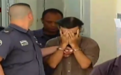 One of the suspects in the murder of Jerusalem resident Shlomo Sami Marciano is seen being led into court. (Screen capture: Channel 2)