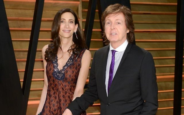 Sir Paul McCartney and wife Nancy Shevell attend the 2014 Vanity Fair Oscar Party on March 2, 2014, in West Hollywood, California. (Evan Agostini/Invision/AP)