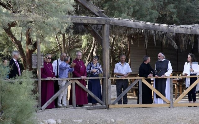 The Archbishop of Canterbury, Justin Welby, center left, visits the archaeological site al-Maghtas in Jordan Wednesday  believed to be the place where John the Baptist baptized Jesus of Nazareth on May, 3, 2017. (AP Photo/Sam McNeil)