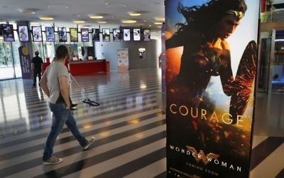 A man walks past a poster promoting the movie, Wonder Woman, at a cinema in downtown Beirut, Lebanon, Tuesday, May 30, 2017. (AP Photo/Hussein Malla)