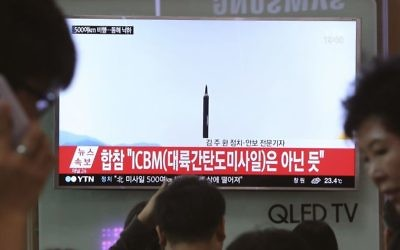 FILE - In this May 21, 2017 file photo people watch a TV news program showing a file image of a missile launch conducted by North Korea, at the Seoul Railway Station in Seoul, South Korea. (AP Photo/Ahn Young-joon, File)