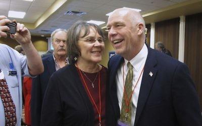 Greg Gianforte (R) receives congratulations from a supporter in Helena, Montana, March 6, 2017. (AP Photo/Matt Volz, File)