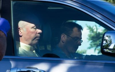 Republican candidate for Montana's only U.S. House seat, Greg Gianforte, sits in a vehicle near a Discovery Drive building Wednesday, May 24, 2017, in Bozeman, Montana. (Freddy Monares/Bozeman Daily Chronicle via AP)