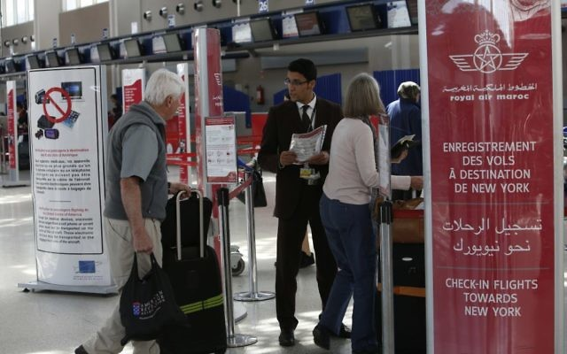 In this photo dated Thursday, March 29, 2017, airport staff inform passengers at the check-in area at Casablanca Mohammed V International Airport, Morocco of the ban on in-flight laptops and tablets.  (AP Photo/ Abdeljalil Bounhar)