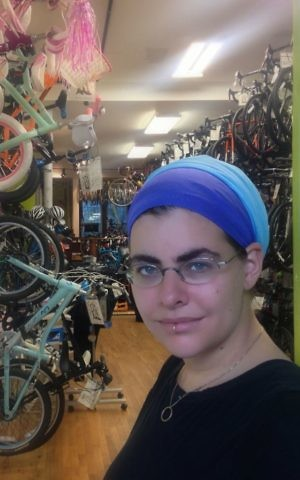 Nechama Levy, who participates in a few Crown Heights independent prayer groups, is involved in another Brooklyn trend: Her bike shop, Bicycle Roots, is also in the neighborhood. (Courtesy of Levy/via JTA)