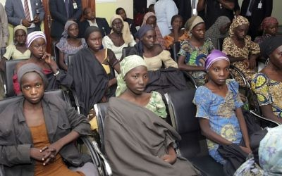 File: In this Thursday, Oct. 13, 2016 file photo released by the Nigeria State House, Chibok schoolgirls recently freed from Islamic extremist captivity are seen during a meeting with Nigeria's Vice President Yemi Osinbajo in Abuja, Nigeria. (Sunday Aghaeze/Nigeria State House via AP, File)