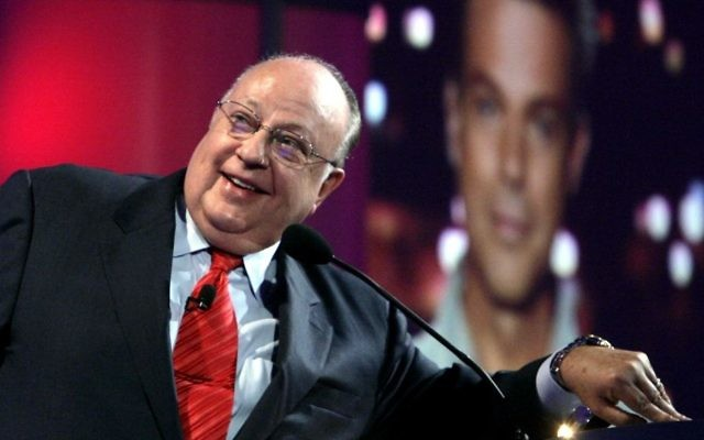 In this July 24, 2006 file photo, Roger Ailes, chairman and chief executive officer of Fox News, listens as anchor Shepard Smith, seen on screens in front and behind him, as Smith talks to the audience via satellite from Israel, at the Summer Television Critics Association Press Tour in Pasadena, Calif. Fox News said on Thursday, May 18, 2017, that Ailes has died. He was 77. (AP Photo/Reed Saxon)
