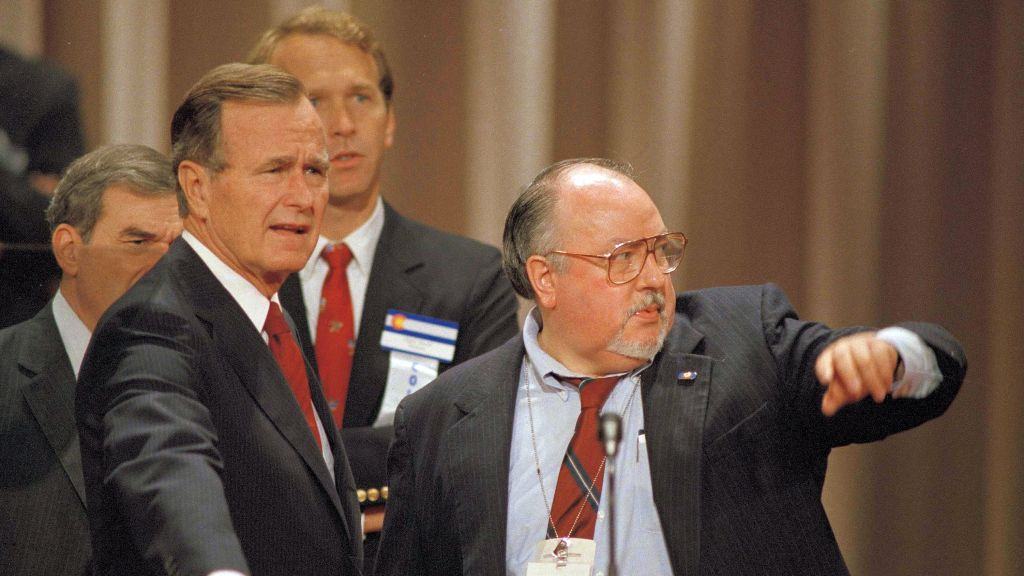 In this Aug. 17, 1988 file photo, Vice President George H.W. Bush, left, gets some advice from his media advisor, Roger Ailes, right, as they stand behind the podium at the Superdome in New Orleans, La., prior to the start of the Republican National Convention. (AP Photo/Ron Edmonds)