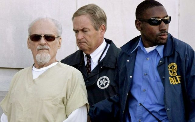 Tony Alamo (L) is escorted to a waiting police car outside the federal courthouse in Texarkana, Arkansas,  July 23, 2009. (AP Photo/Danny Johnston, File)