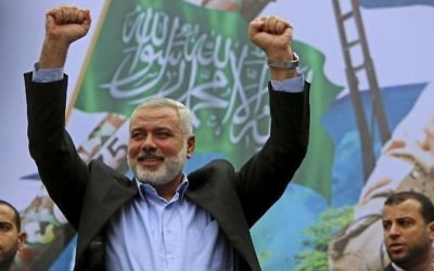 Hamas leader Ismail Haniyeh greets supporters during a rally to commemorate the 27th anniversary of the Hamas militant group in Jebaliya in the northern Gaza Strip, December 12, 2014 . (AP/Adel Hana)