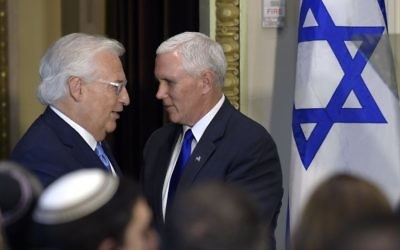 Vice President Mike Pence, right, is introduced to speak by US Ambassador to Israel David Friedman, left, in the Indian Treaty Room in the Eisenhower Executive Office Building on the White House complex in Washington, Tuesday, May 2, 2017, during a ceremony commemorating Israeli Independence Day. (AP/Susan Walsh)