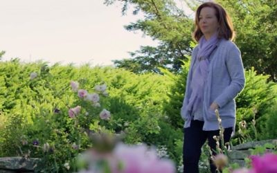 Author Martha Hall Kelly in the garden which inspired her book, 'Lilac Girls.' (YouTube screenshot)