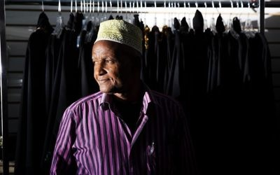 Mohamoud Saed, a refugee from Somalia, helps out in a friend's clothing store in Clarkston, Ga., Tuesday, May 2, 2017. (AP/David Goldman)