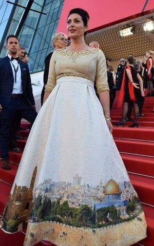 Miri Regev wears a Jerusalem dress on the red carpet at the opening of the film festival in Cannes, France, on Wednesday, May 17, 2017 (Eli Sabati)