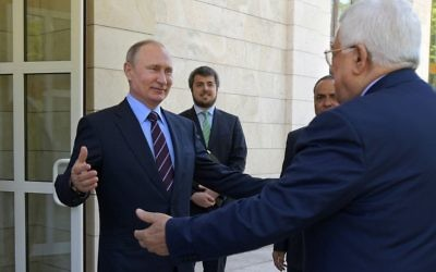 Russian President Vladimir Putin (left) greets Palestinian Authority President Mahmoud Abbas at the Bocharov Ruchei residence in the Black Sea resort of Sochi, Russia, May 11, 2017. (Alexei Druzhinin/Sputnik, Kremlin Pool Photo via AP)