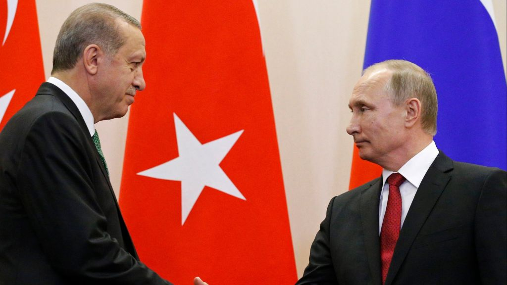 Russian President Vladimir Putin, (r), and Turkish President Recep Tayyip Erdogan shake hands after a news conference following their talks in Putin's residence in the Russian Black Sea resort of Sochi, Russia, Wednesday, May 3, 2017. (AP Photo/Alexander Zemlianichenko, Pool)