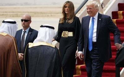 US President Donald Trump, accompanied by first lady Melania Trump, smiles at Saudi King Salman, left, upon his arrival at a welcome ceremony at the Royal Terminal of King Khalid International Airport, Saturday, May 20, 2017, in Riyadh.  (AP Photo/Evan Vucci)