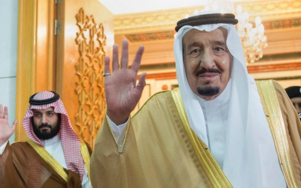 In this April 5, 2017 photo, released by the Saudi Press Agency, SPA, Saudi King Salman, right, and then Defense Minister and Deputy Crown Prince Mohammed bin Salman wave as they leave the hall after talks with the British prime minister, in Riyadh, Saudi Arabia. (Saudi Press Agency via AP)