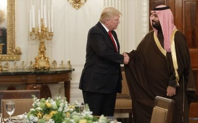In this March 14, 2017, photo, President Donald Trump shakes hands with Saudi Defense Minister and Deputy Crown Prince Mohammed bin Salman, in the State Dining Room of the White House in Washington. (AP Photo/Evan Vucci)