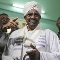 File: Sudanese President Omar al-Bashir prepares to cast his ballot for the country's presidential and legislative elections in Khartoum, Sudan, April 13, 2015. (AP Photo/Mosa'ab Elshamy, File)