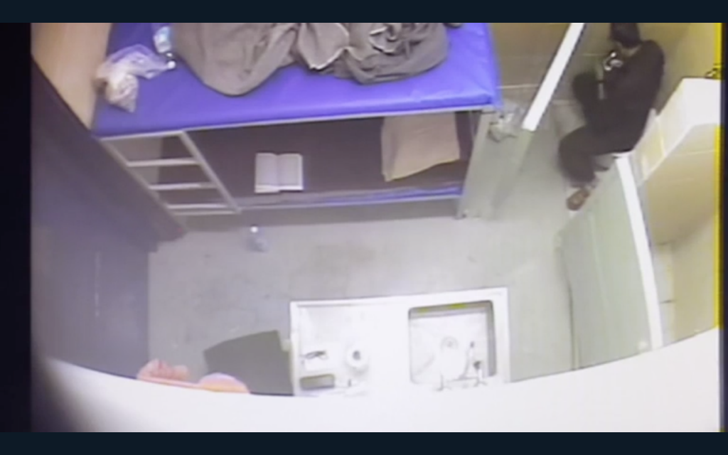 Marwan Barghouti seen in video footage released May 7, 2017, unwrapping a candy bar in his cell while ostensibly leading a hunger strike among Palestinian prisoners. (Screen capture: Israeli Prison Service)