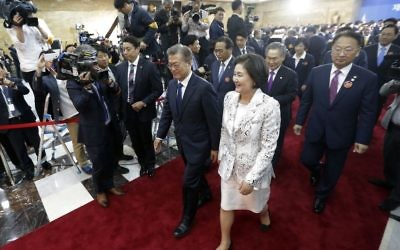 Newly elected South Korean President Moon Jae-in, center left, and his wife Kim Jung-suk leave after his inauguration ceremony at the National Assembly in Seoul, South Korea, Wednesday, May 10, 2017 (AP/Ahn Young-joon)