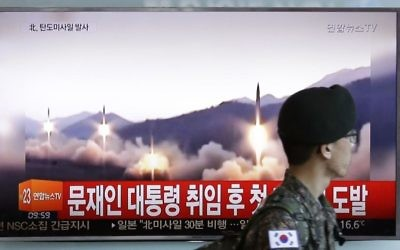 Illustrative: A South Korean army soldier walks by a TV news program showing a file image of missiles being test-launched by North Korea, at the Seoul Railway Station in Seoul, South Korea, Sunday, May 14, 2017. (AP/Ahn Young-joon)