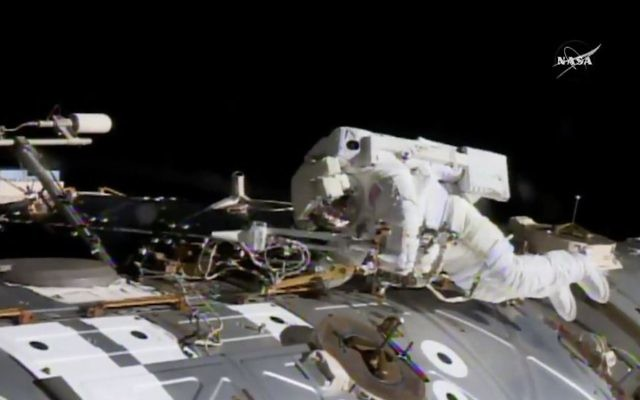 In this NASA provided frame from video, NASA astronaut Jack Fischer works to install antennas at the International Space Station while astronaut Peggy Whitson, not pictured, works on repairs Tuesday, May 23, 2017. (NASA via AP)