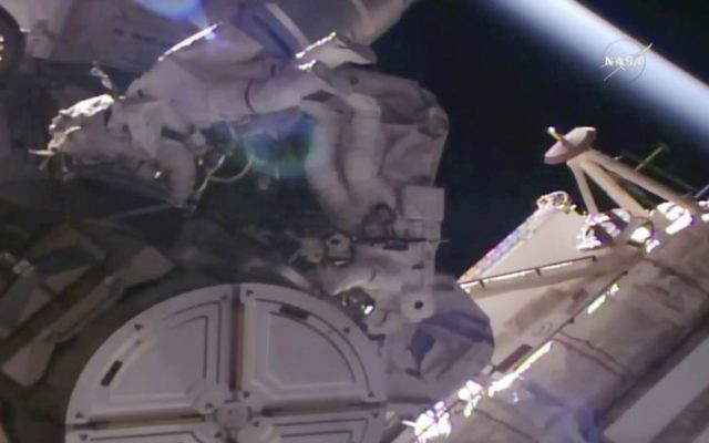 In this NASA provided frame from video, NASA astronauts Peggy Whitson, left, and Jack Fischer go out on a spacewalk to make repairs outside the International Space Station on Tuesday, May 23, 2017. (NASA via AP)