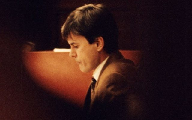 In this photo from February 2, 1995, John Ausonius sits during a trial in Stockholm's district court. (Tobias Rostlund/TT News Agency via AP, File)