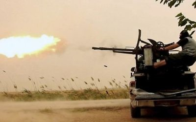 Illustrative: This undated image posted online Monday, May 1, 2017, by supporters of the Islamic State militant group on an anonymous photo sharing website, purports to show an Islamic State fighter firing his weapon during clashes with US-backed Kurdish-led Syrian Democratic Forces, in the northern Syrian province of Raqqa. (Militant Photo via AP)