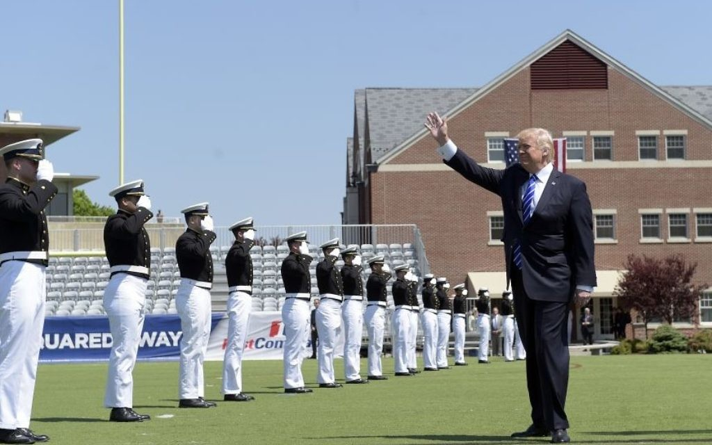 President Donald Trump waves as he arrives to give the commencement address at the US Coast Guard Academy, Wednesday, May 17, 2017, in New London, Conn. (AP Photo/Susan Walsh)