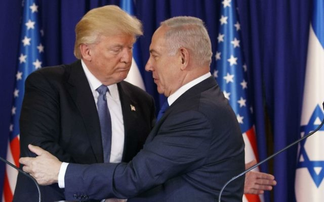 US President Donald Trump embraces Prime Minister Benjamin Netanyahu after making a joint statement in Jerusalem, Monday, May 22, 2017. (AP Photo/Evan Vucci)