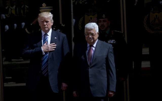 US President Donald Trump , left, and President of the Palestinian Authority Mahmoud Abbas stand for their national anthems during an arrival ceremony ahead of their meeting in the West Bank city of Bethlehem, May 23, 2017. (AP/Nasser Nasser)