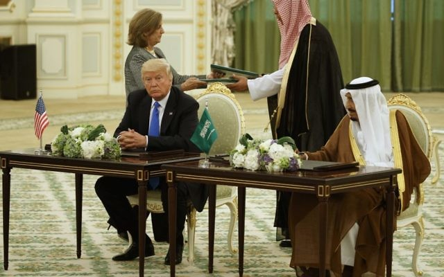 US President Donald Trump and Saudi King Salam participate in a signing ceremony at the Royal Court Palace, Saturday, May 20, 2017, in Riyadh. (AP Photo/Evan Vucci)