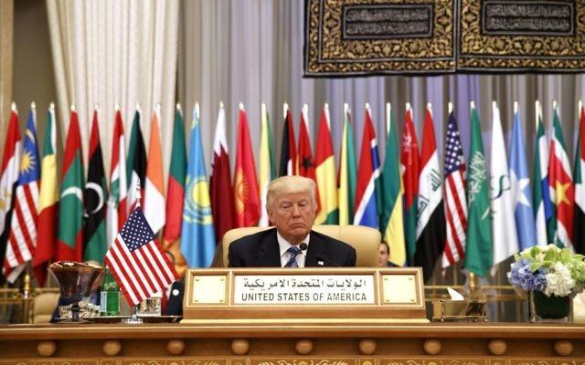 US President Donald Trump waits to deliver a speech to the Arab Islamic American Summit, at the King Abdulaziz Conference Center, in Riyadh, Saudi Arabia, May 21, 2017. (AP/Evan Vucci)