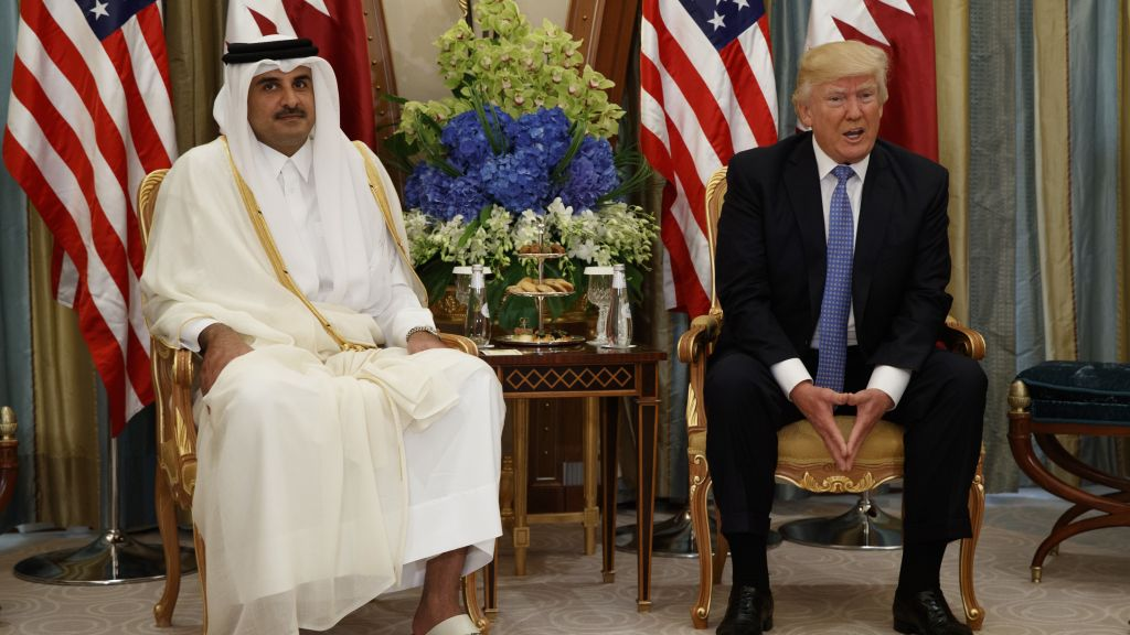 US President Donald Trump, right, holds a bilateral meeting with Qatar's Emir Sheikh Tamim Bin Hamad Al-Thani, Sunday, May 21, 2017, in Riyadh. (AP Photo/Evan Vucci)