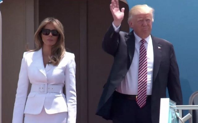 US President Donald Trump, flanked by his wife, Melania, emerges from Air Force One after landing in Israel (screen capture: GPO)