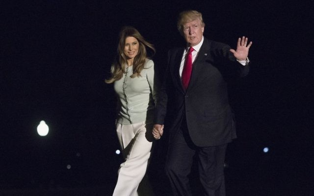 As they return from Sigonella, Italy, US President Donald Trump and first lady Melania Trump walk from Marine One across the South Lawn to White House in Washington, May 27, 2017. (AP/Carolyn Kaster)