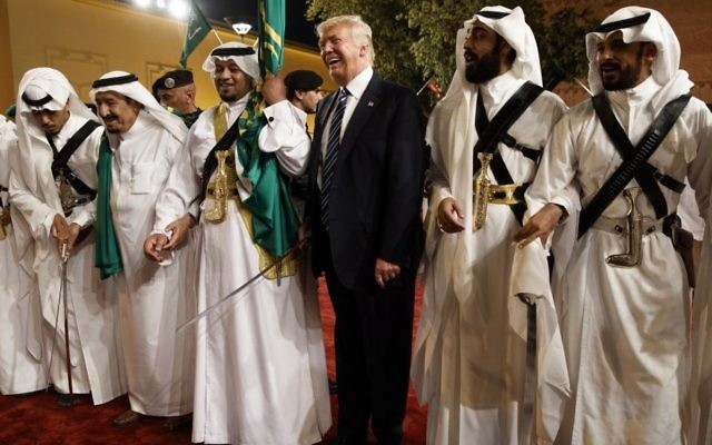 US President Donald Trump holds a sword and dances with traditional dancers during a welcome ceremony at Murabba Palace in Riyadh, 20, 2017. (AP/Evan Vucci)