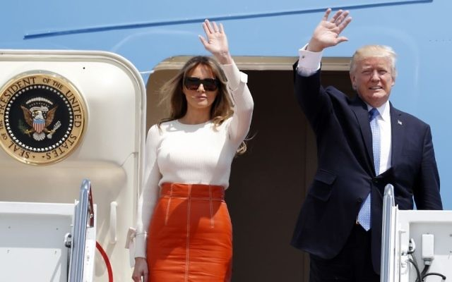 US President Donald Trump and first lady Melania Trump wave as they board Air Force One at Andrews Air Force Base, Maryland, May 19, 2017, prior to his departure on his first overseas trip. (AP Photo/Alex Brandon)