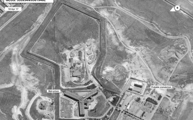 A satellite image of what the State Department described as a building in a prison complex in Syria that was modified to support a crematorium, April 18, 2017. (State Department/DigitalGlobe via AP)